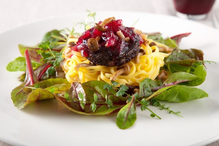 Delicious pasta dish with blood sausage and small mushrooms photo