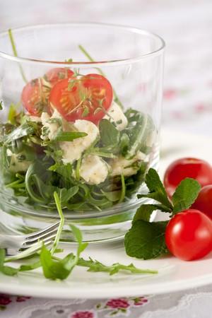 arugola: Delicious healthy salad with feta cheese, rocket and mozarella Stock Photo