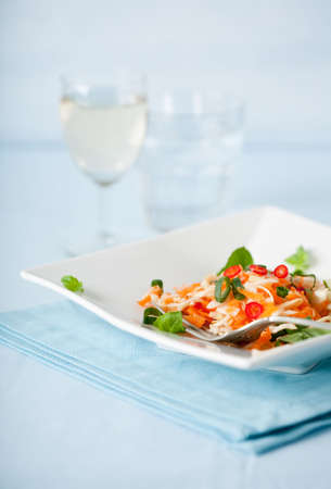 Delicious Asian carrot salad served with a glass of white wine