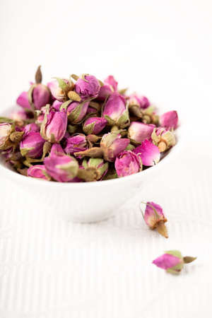 Small pink rosebuds dried in a bowl photo