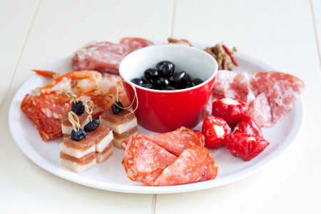 Plate of antipasti with chorizo, cheese, poppers, pepper, salami, and olives Stock Photo - 4750982