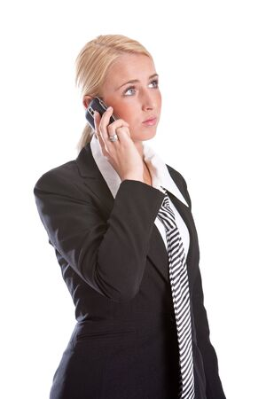 Pretty business woman listening intently on the phone Stock Photo - 4873784
