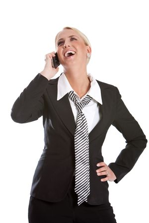 Beautiful business woman listening to her phone laughing Stock Photo - 4873781