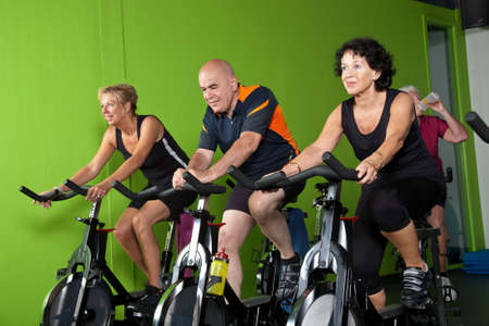 Senior people in a spinning class exercising Stock Photo