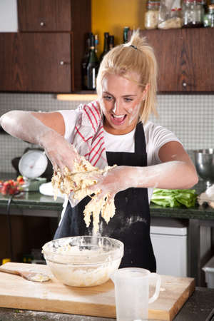 Female chef with her hands covered in sticky dough Stock Photo - 5213088