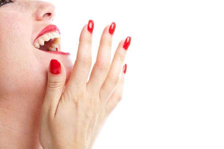 laughing out loud: Mujer riendo en voz alta con su mano delante de su boca Foto de archivo