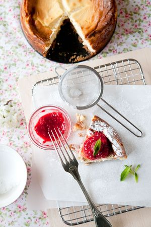 Delicious freshly baked cheesecake with raspberry coulis on top Stock Photo - 5381292