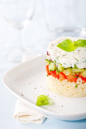 Delicious and fresh appetizer with risoni, tomatoes and cucumber photo