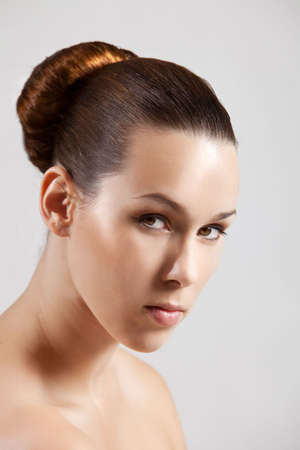 Beautiful brunette with simpel and elegant hairstyle photo