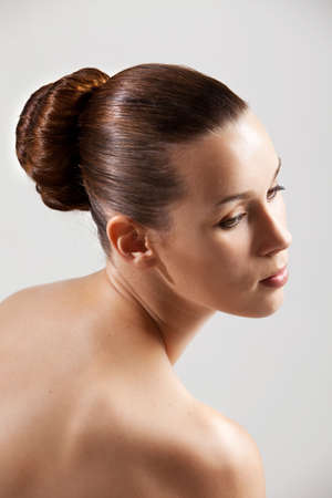 Beautiful and elegant woman with bare shoulders and stylish hair Stock Photo