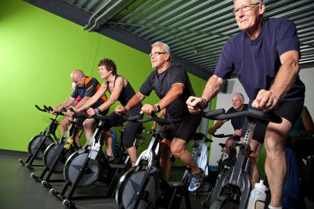 Group of seniors cycling in a spinning class