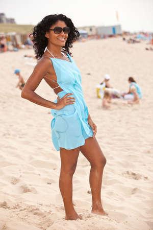 Beautiful brazilian girl standing on the beach Stock Photo - 5609265