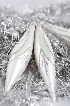 pointy: Silver pointy christmas baubles on shiny background Stock Photo