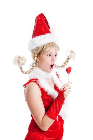 humoristic: Cute joven vestido de santa looking conmocionado en su lollipop