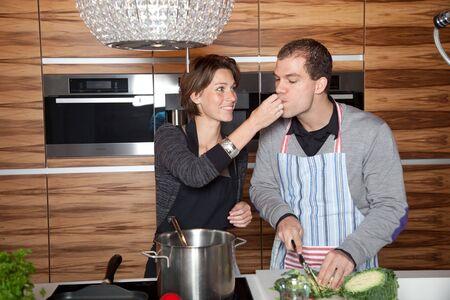 Pretty girl letting her boyfriend taste something Stock Photo - 6465880