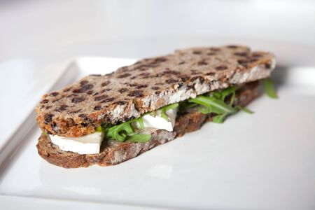arugola: Healthy sandwich with goatcheese, honey and rocket salad