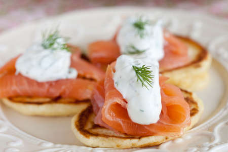Small pancake with salmon and sourcream and dille
