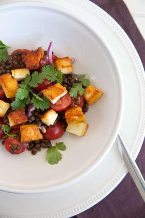 haloumi: Delicious healthy salad with haloumi, tomatoes, lentils and cilantro