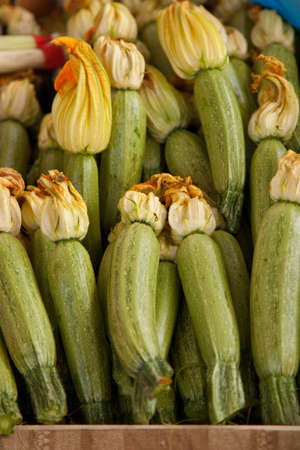 courgette: Fresh courgette with courgette flowers still attached Stock Photo