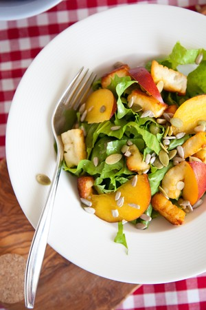 endive: Delicious salad with endive, haloumi and nectarines Stock Photo