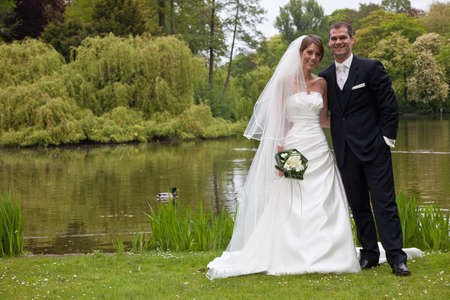 Weddingcouple posing in the parc together photo