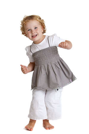 Cute little girl dancing on her bare feet having fun