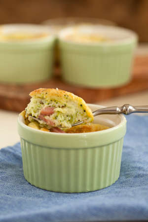 Small broccoli ham souffle served in a little ramekin
