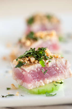 amuse: Delicious and healthy appetizer with fresh tuna, peanuts and herbs