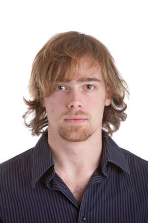 Goodlooking young caucasian man with half long hair on white background Stock Photo