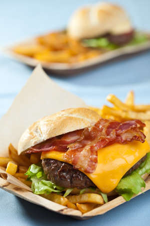 Big cheeseburger with bacon, fries and mayonaise photo