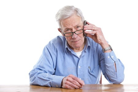 Senior man on the phone looking seius on white background Stock Photo - 11112720
