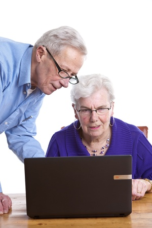 Elderly man and woman behind a laptop Stock Photo - 11112738