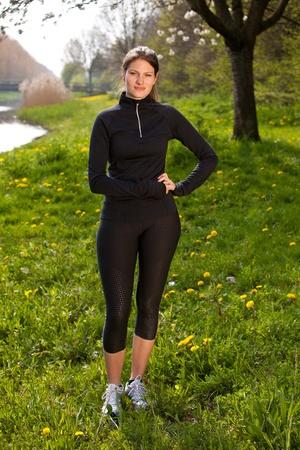 sports wear: Beautiful girl in sports wear standing in a field