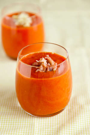 Glass filled with delicious cold soup; gazpacho photo
