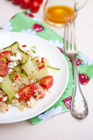 Refreshing and healthy quinoa salad with zucchini and tomatoes Stock Photo - 11112706