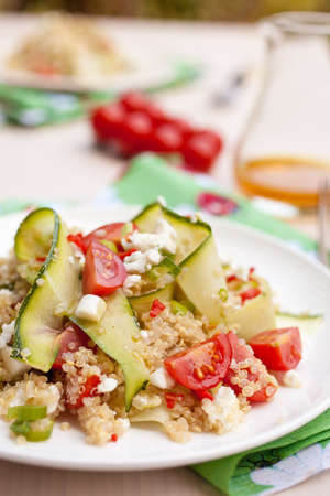 Refreshing and healthy quinoa salad with zucchini and tomatoes photo