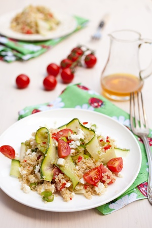 Delicious and fresh salad with quinoa and tomatoes photo