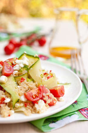 Refreshing and healthy quinoa salad with zucchini and tomatoes Stock Photo - 11112710