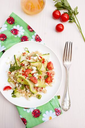 Refreshing and healthy quinoa salad with zucchini and tomatoes Stock Photo - 11112682
