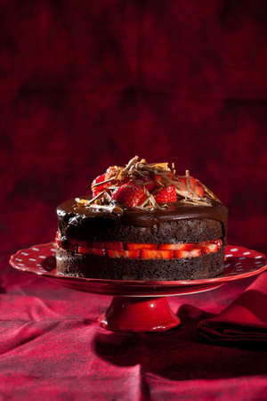 Delicious chocolate strawberry cake with chocolate ganache photo