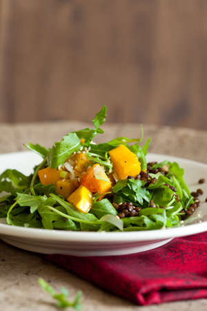 Delicious roasted pumpkin salad with rocket and lentils photo
