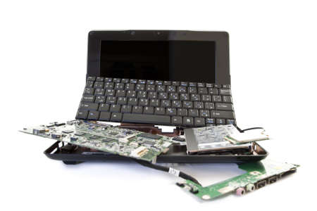 data processor: broken laptop disassembled into parts Stock Photo