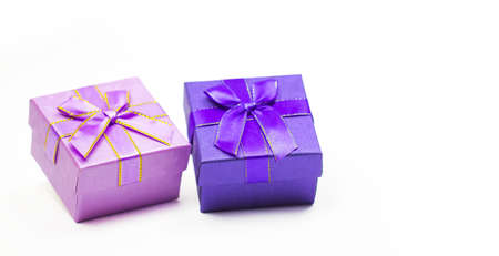 Purple, pink gift box with white background. Holiday greeting card. Christmas, new year, birthday. Space for text