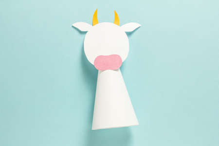 Step-by-step photo instructions on how to make a white bull from paper with your own hands. Symbol of the new year 2021. Simple crafts with children. Step 8. Glue the horns