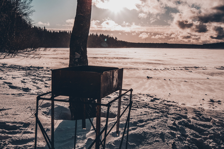 Brazier on the lake. Winter landscape overlooking the winter lake.
