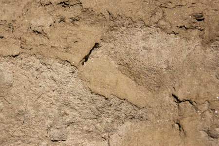 The texture of the sand. Sand quarry. Picturesque texture of sandstones.