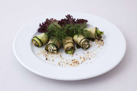 vegetable marrow: Five rolls of vegetable marrow with stuffing on a white plate