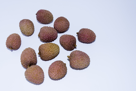 Several lychee fruits on a white background Stock Photo