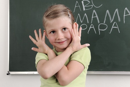 Happy child with painted hands.