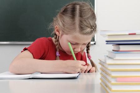 school child in classroom, cute girl  Standard-Bild